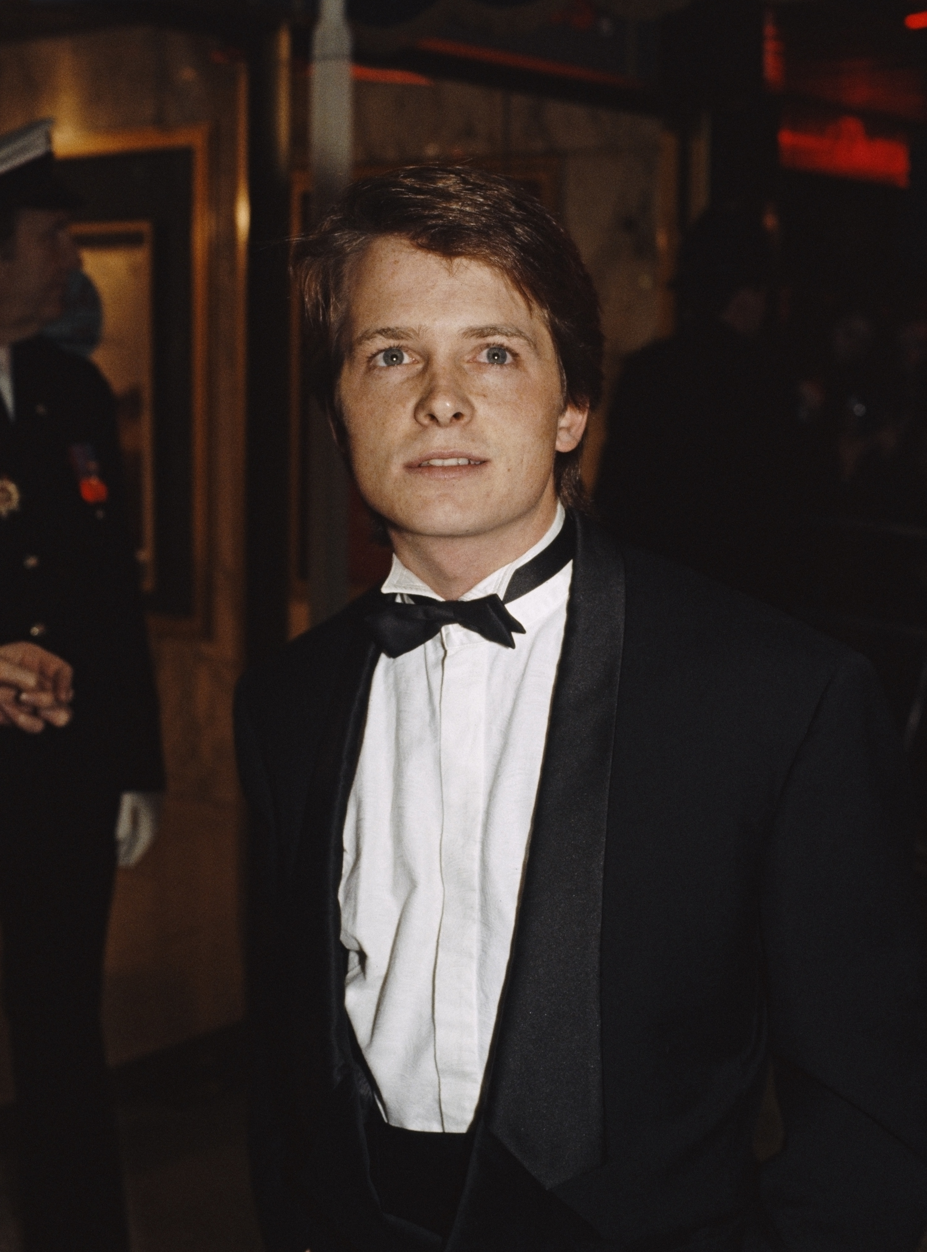 A young Michael wearing a bow-tie