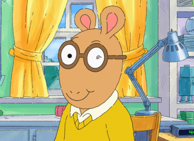 Screenshot of the cartoon character Arthur Read winking.