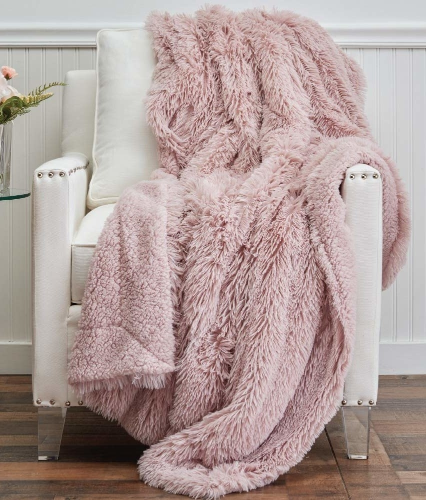 The throw blanket with long shaggy faux fur on one side and sherpa on the other side