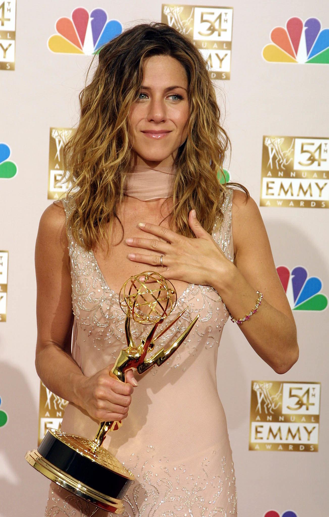 Jen holding an emmy