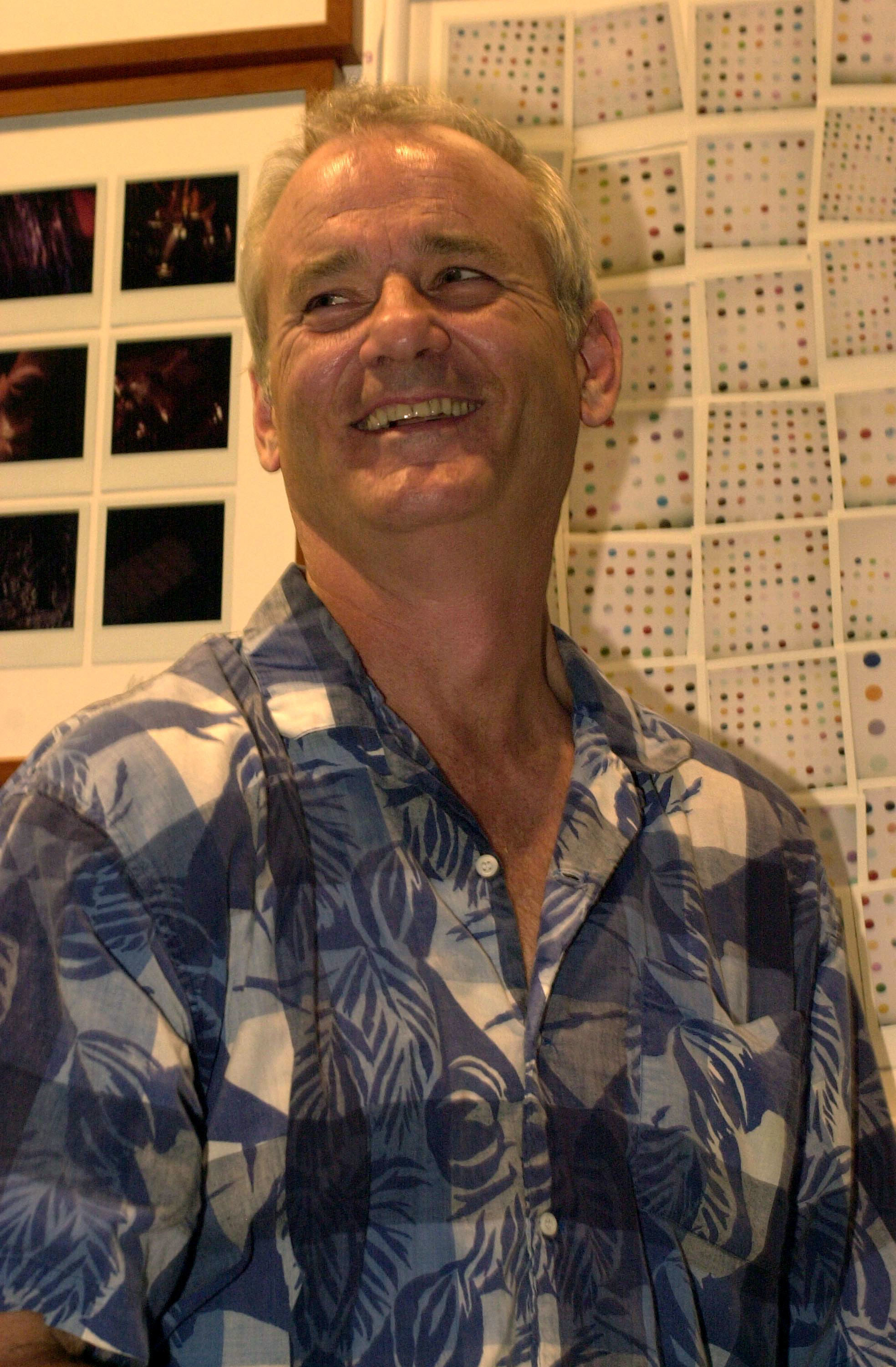 Bill Murray wearing a loose shirt and smiling