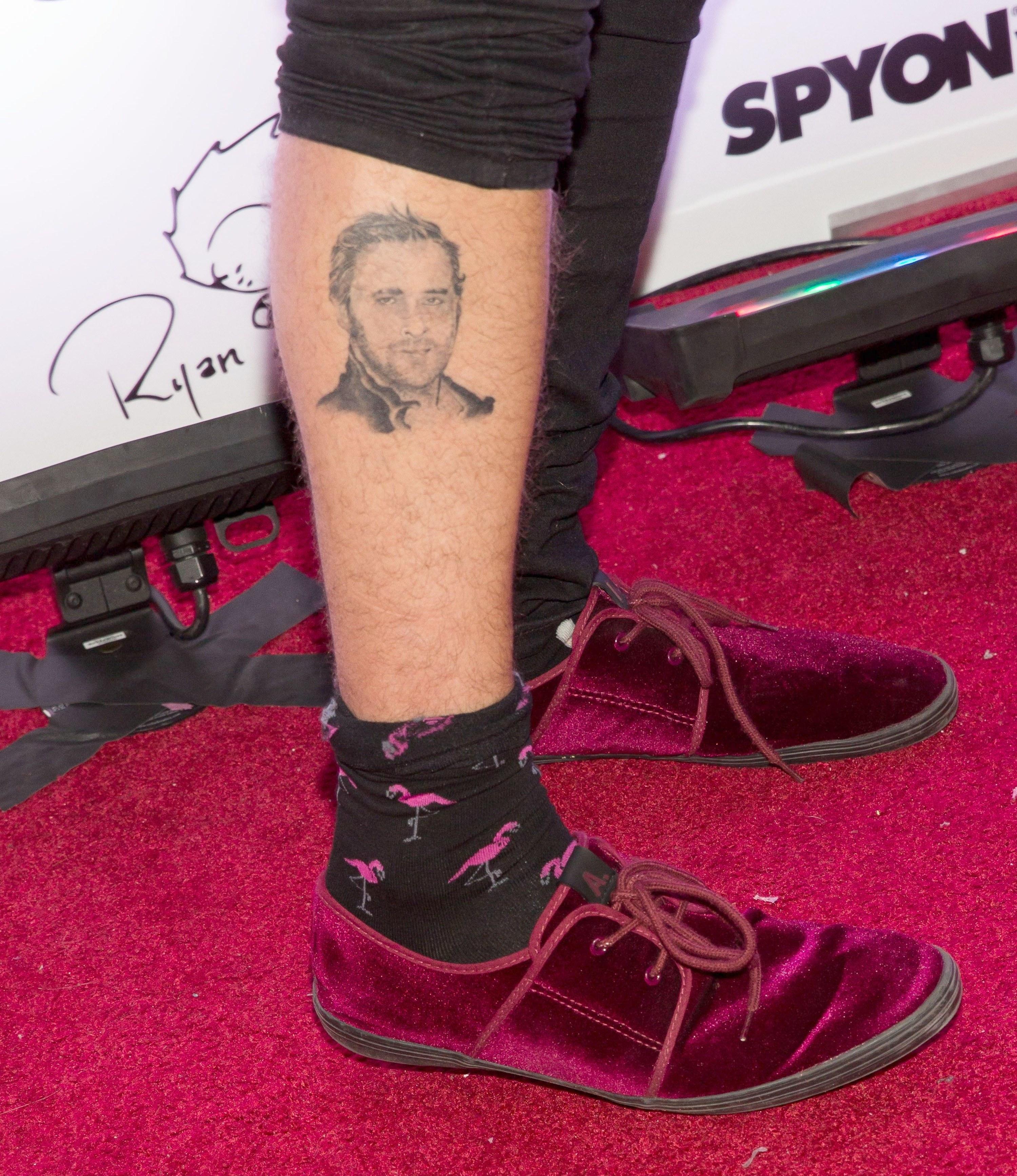 Close-up of Ryan Cabrera's leg — and Ryan Gosling's face tattoo
