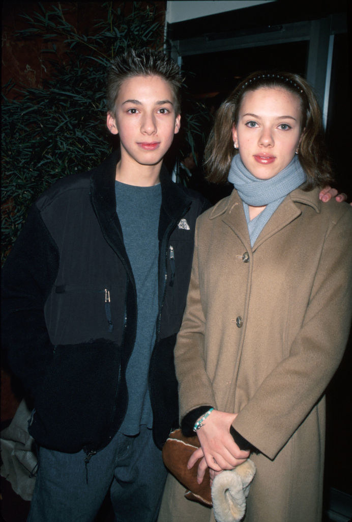 A young Scarlett with her brother