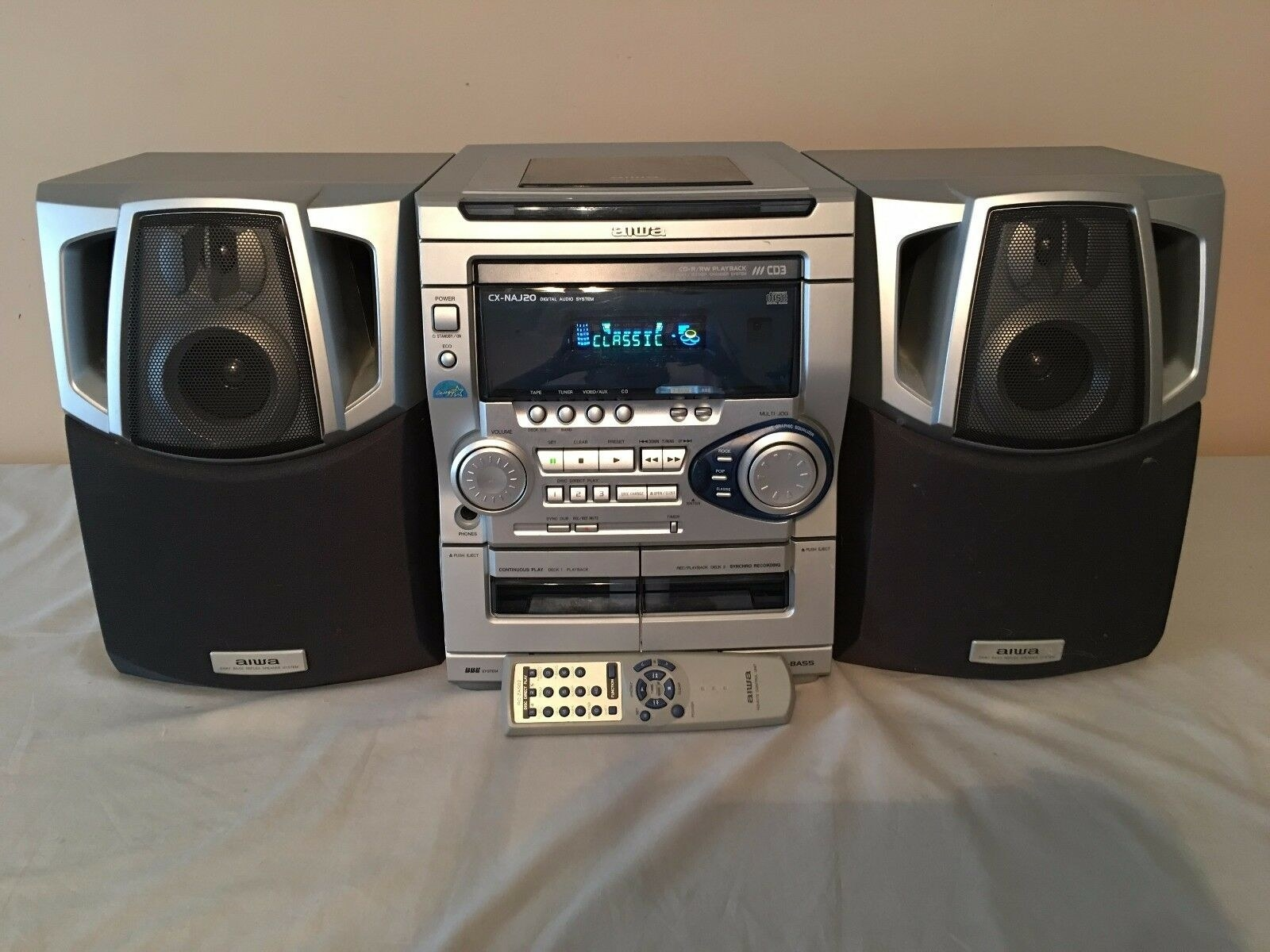 A silver 3-CD player boombox from the late '90s
