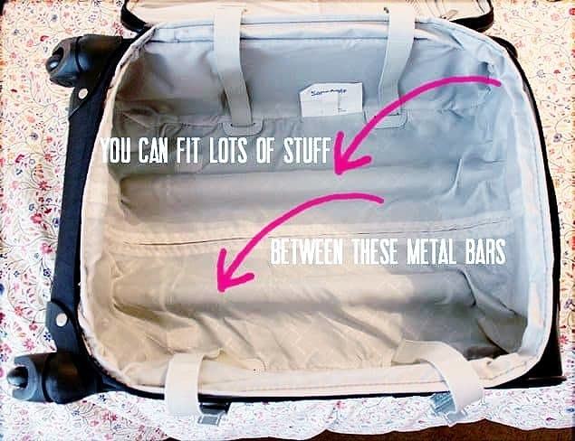 A photo of the space between the metal bars in a rolling suitcase