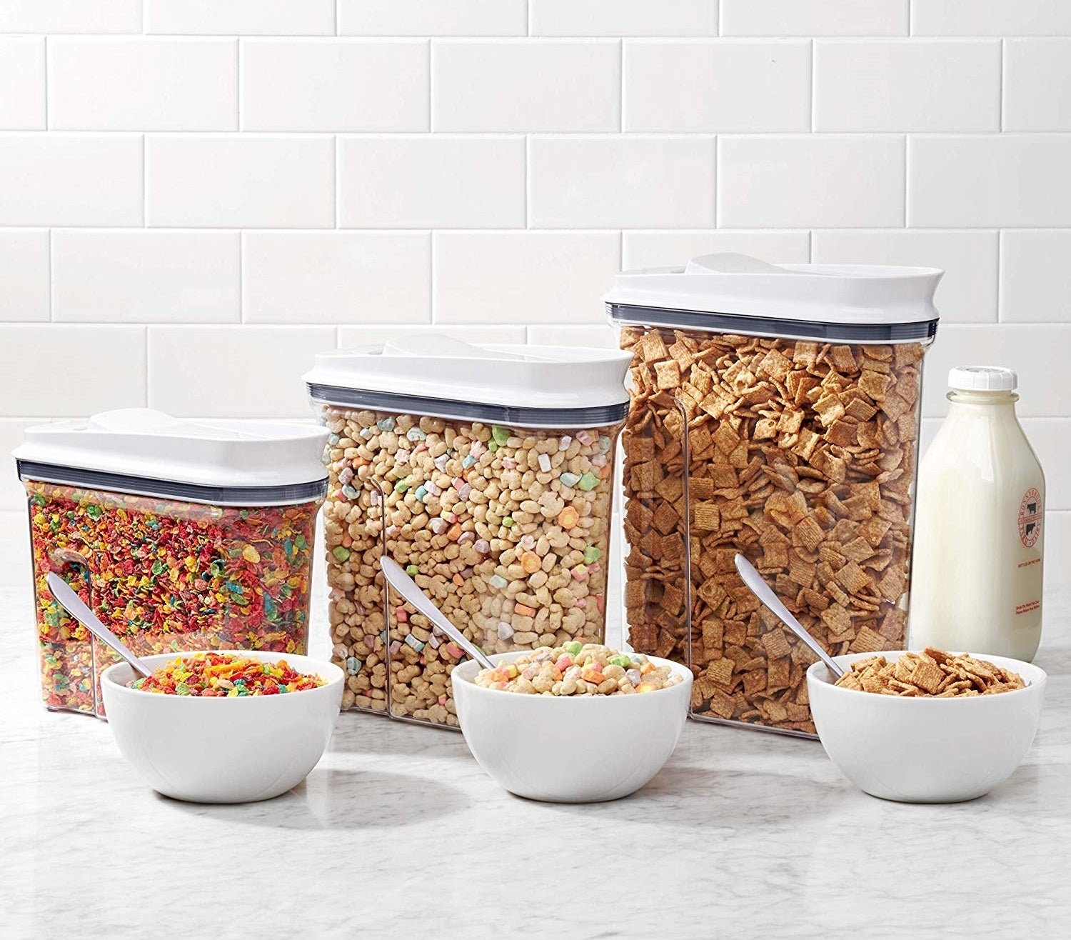 Three containers filled with different types of cereal
