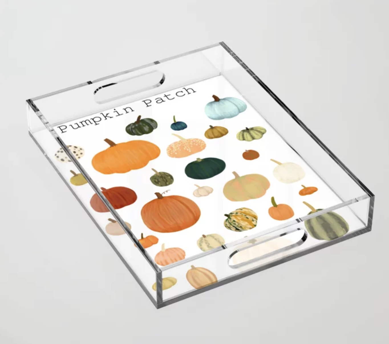 """the acrylic tray features a bunch of colorful pumpkins on it and says """"pumpkin patch"""""""