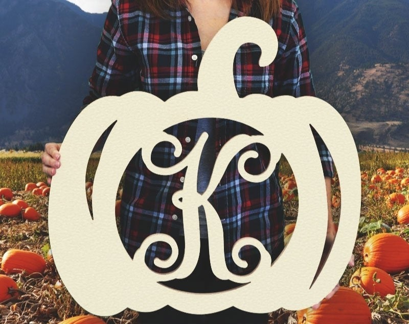 the wooden pumpkin decor with a K in the middle