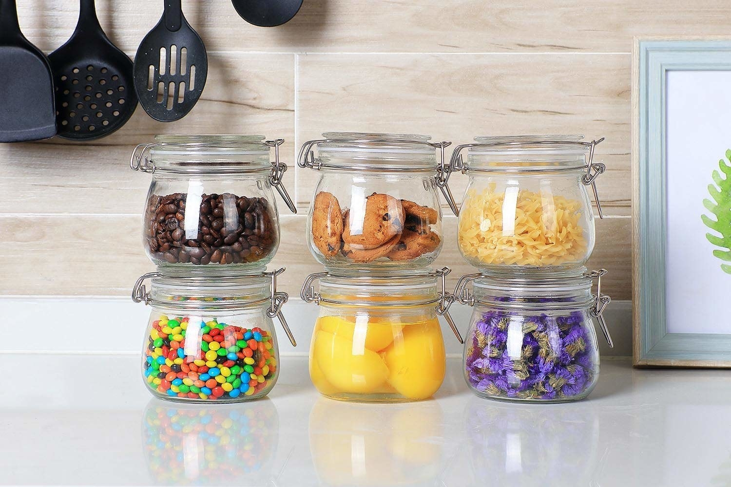 Set of jars with different foods sealed inside with the clamp top