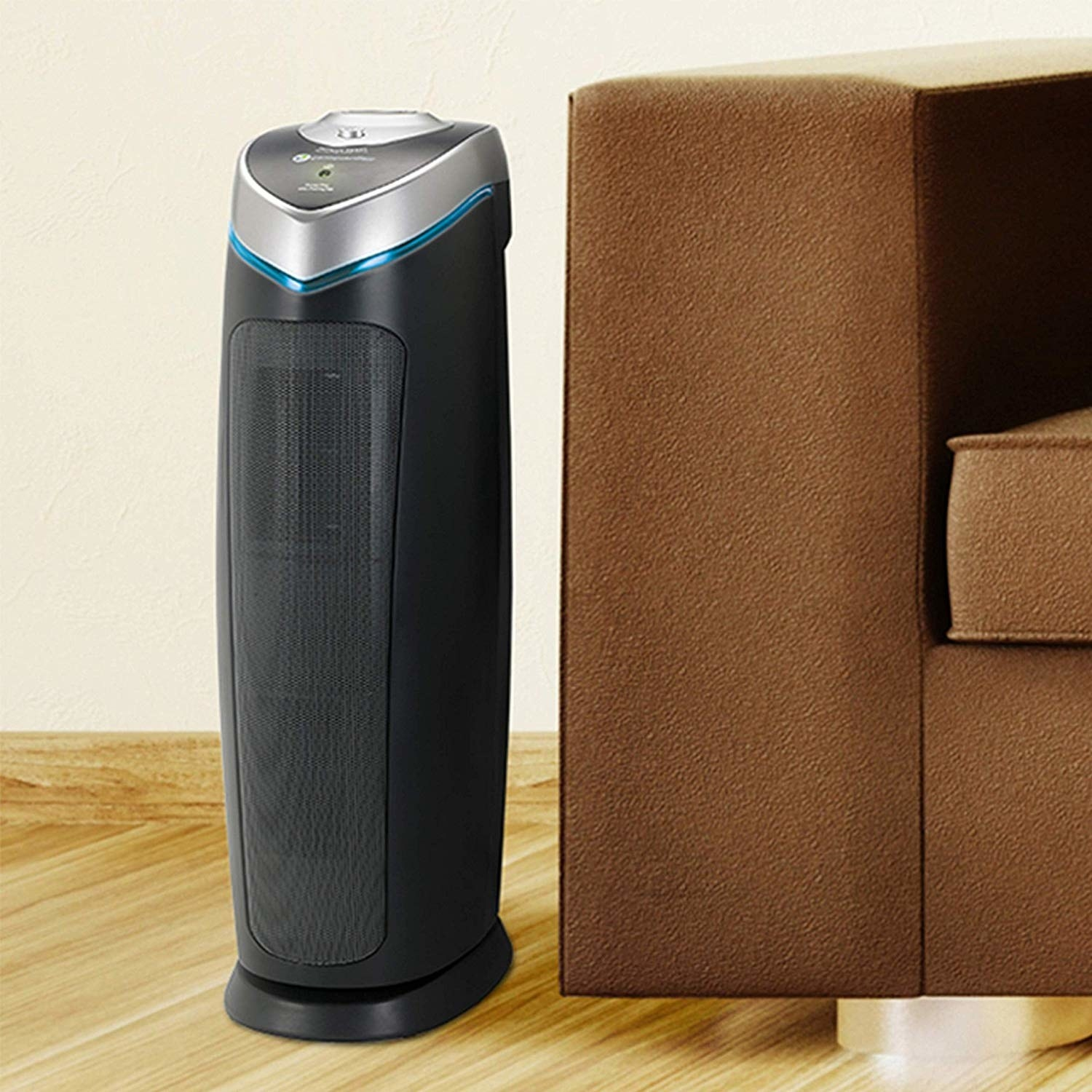 the air purifier next to a brown couch