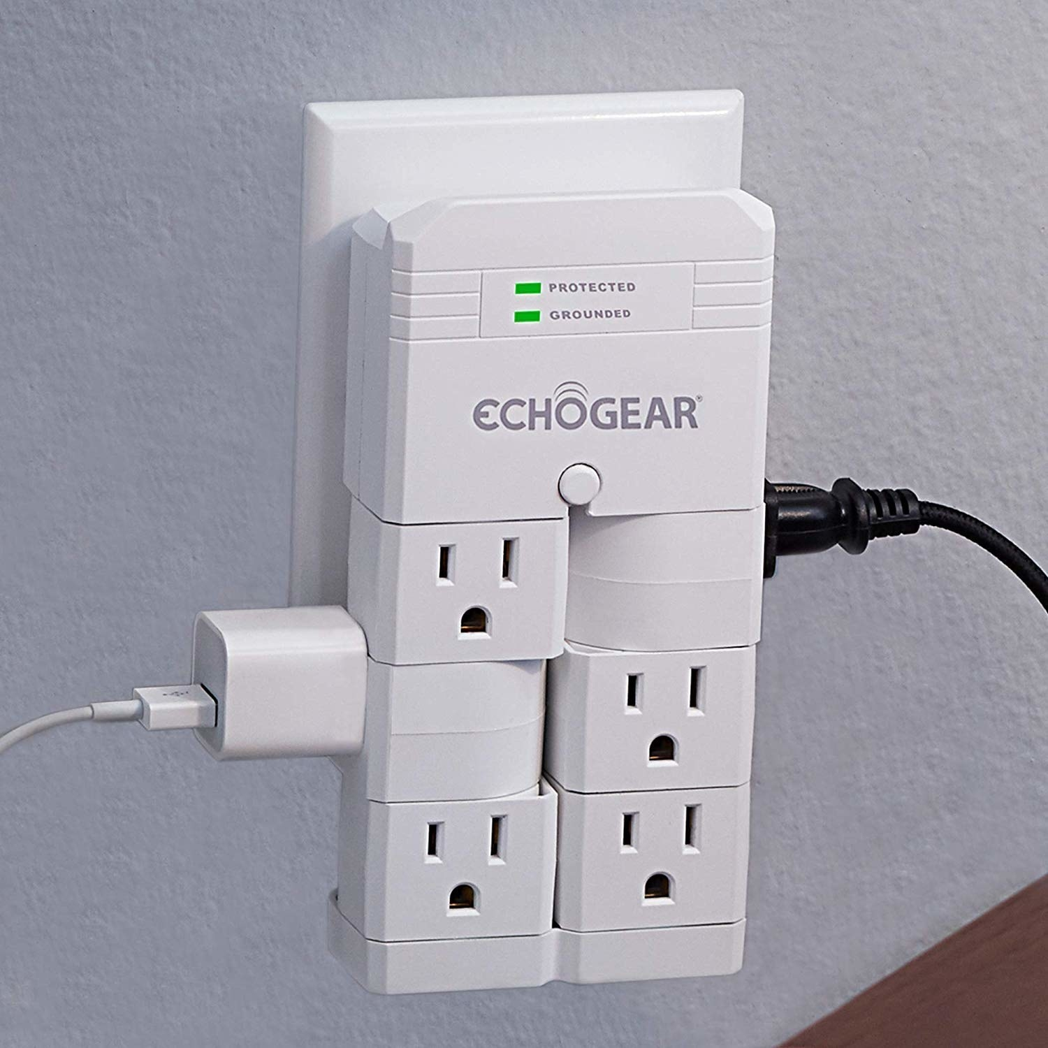 the surge protector with two plugs inserted and four empty sockets remaining