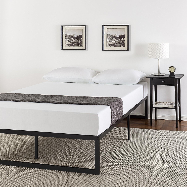 mattress on black minimalist metal frame