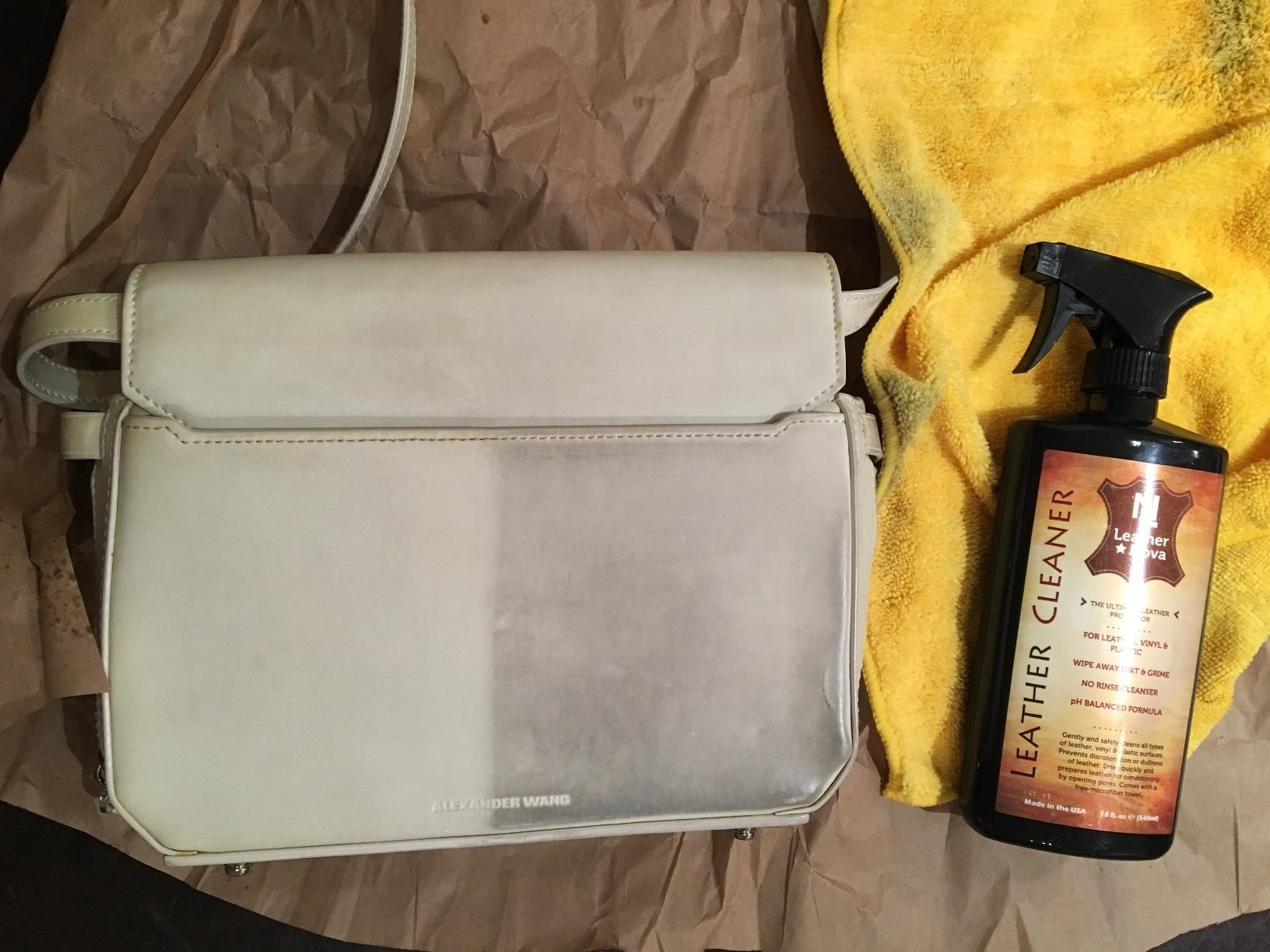 reviewer's leather purse next to spray cleaner looking very dirty on one side and clean on the other