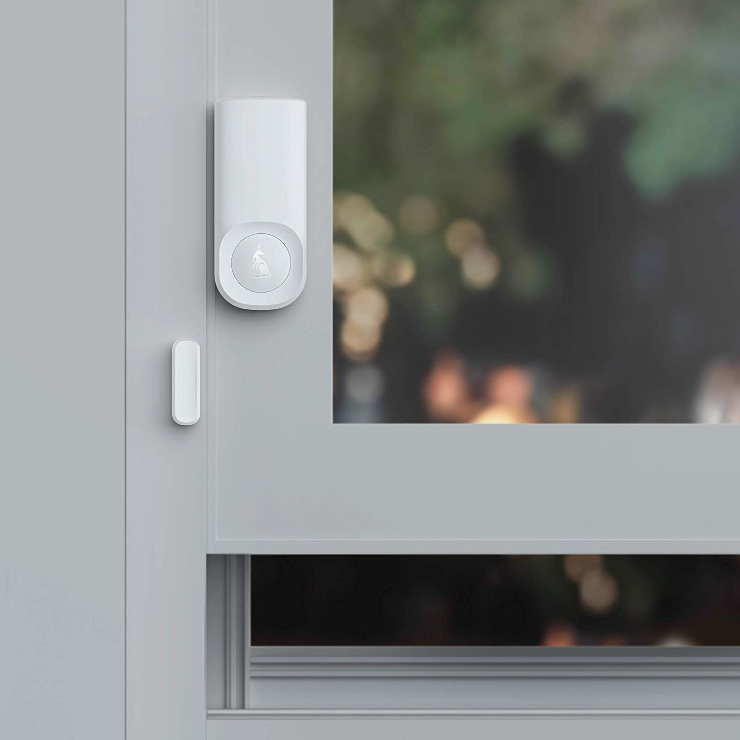 open window with minimalist white motion sensor for security