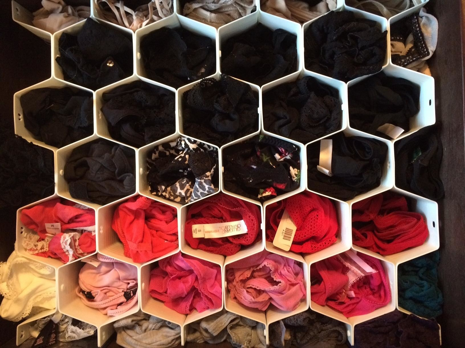 reviewer's underwear drawer with small honey comb-shaped dividers separating each pair