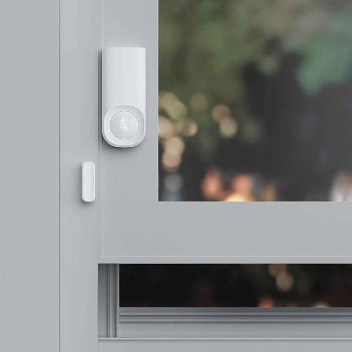 open window with the minimalist little tracker on the window frame