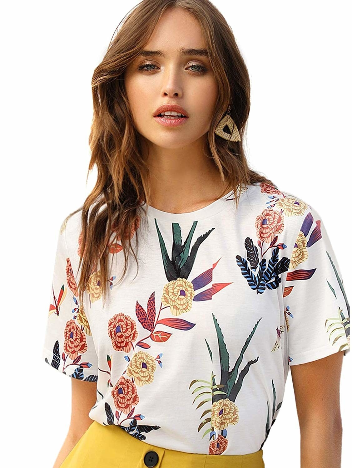 White tee with illustrated leaves and flowers in psychedelic colors and patterns