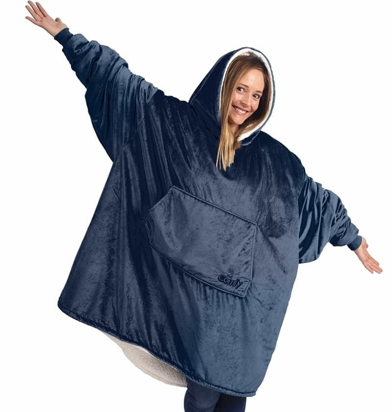 model in extremely oversized blanket sweatshirt hybrid with a hood and large front pocket