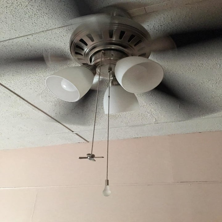 Reviewer image of the chains attached to a ceiling fan and light