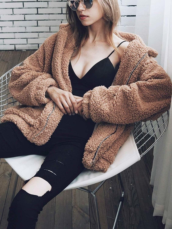 model in light brown zip-up coat