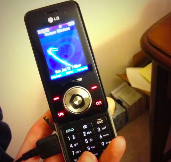 a person holding a chocolate phone