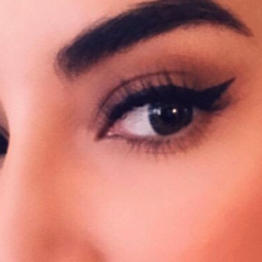 reviewer with winged eyeliner on from the pen