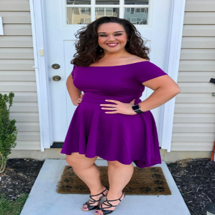A reviewer wearing the above-the-knee dress in purple