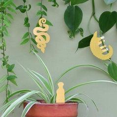 metal animals hanging on plants