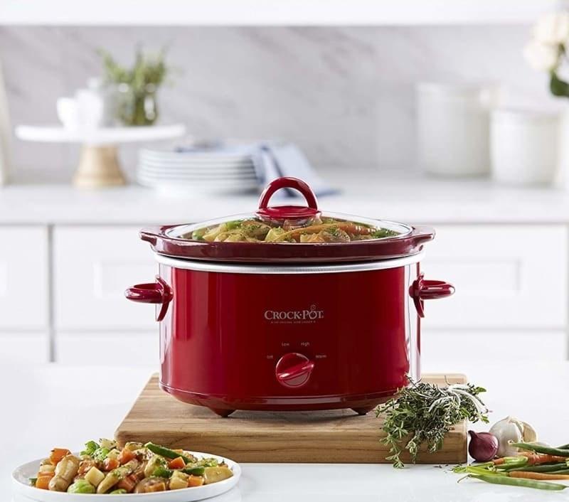 red crock pot full of food