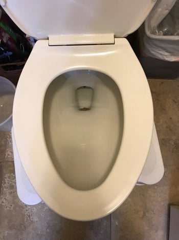 Same reviewer's toilet looking white and clean after using the stone