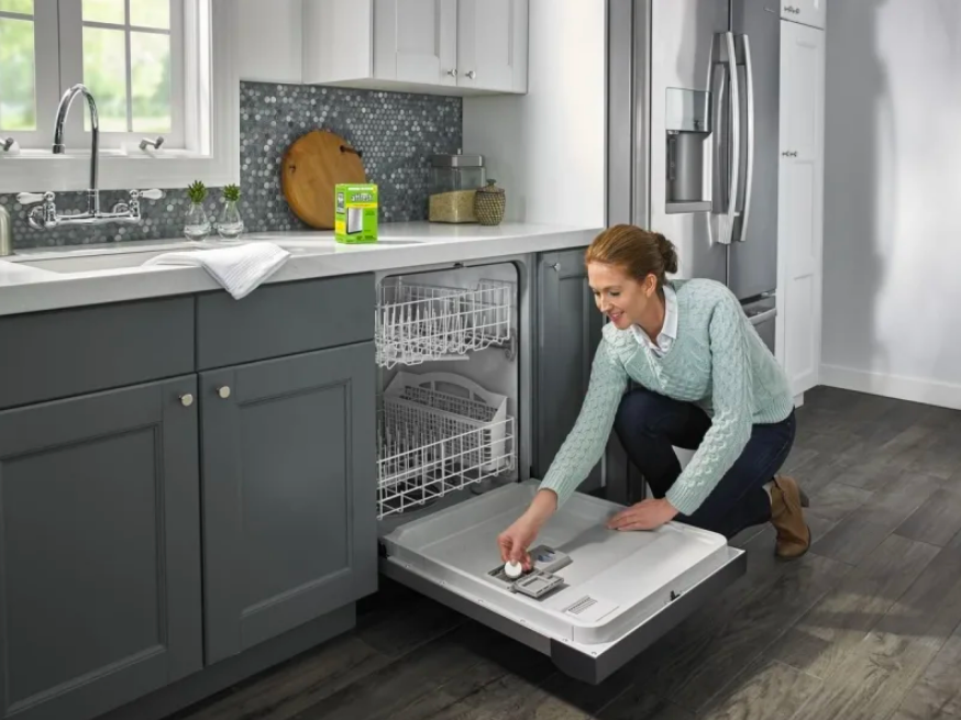 Person placing tablet in dishwasher