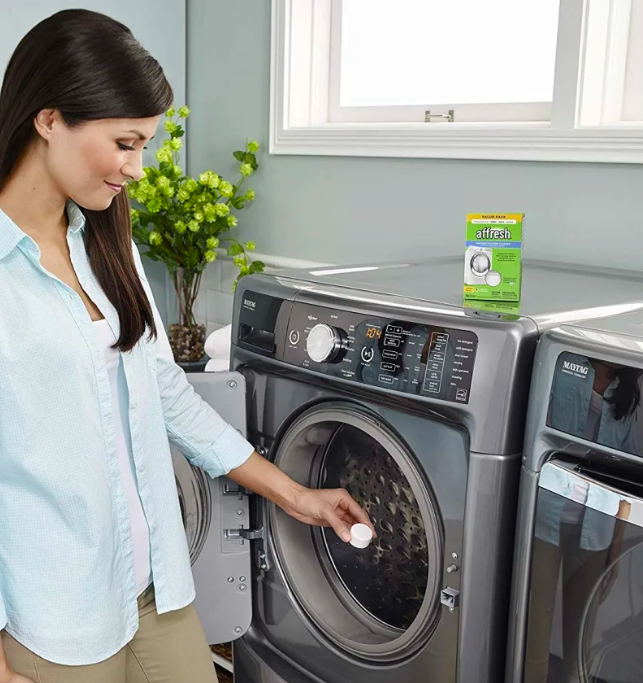 Person putting tablet in washer