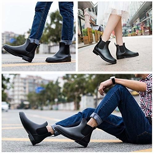 model wearing matte black ankle rain boots