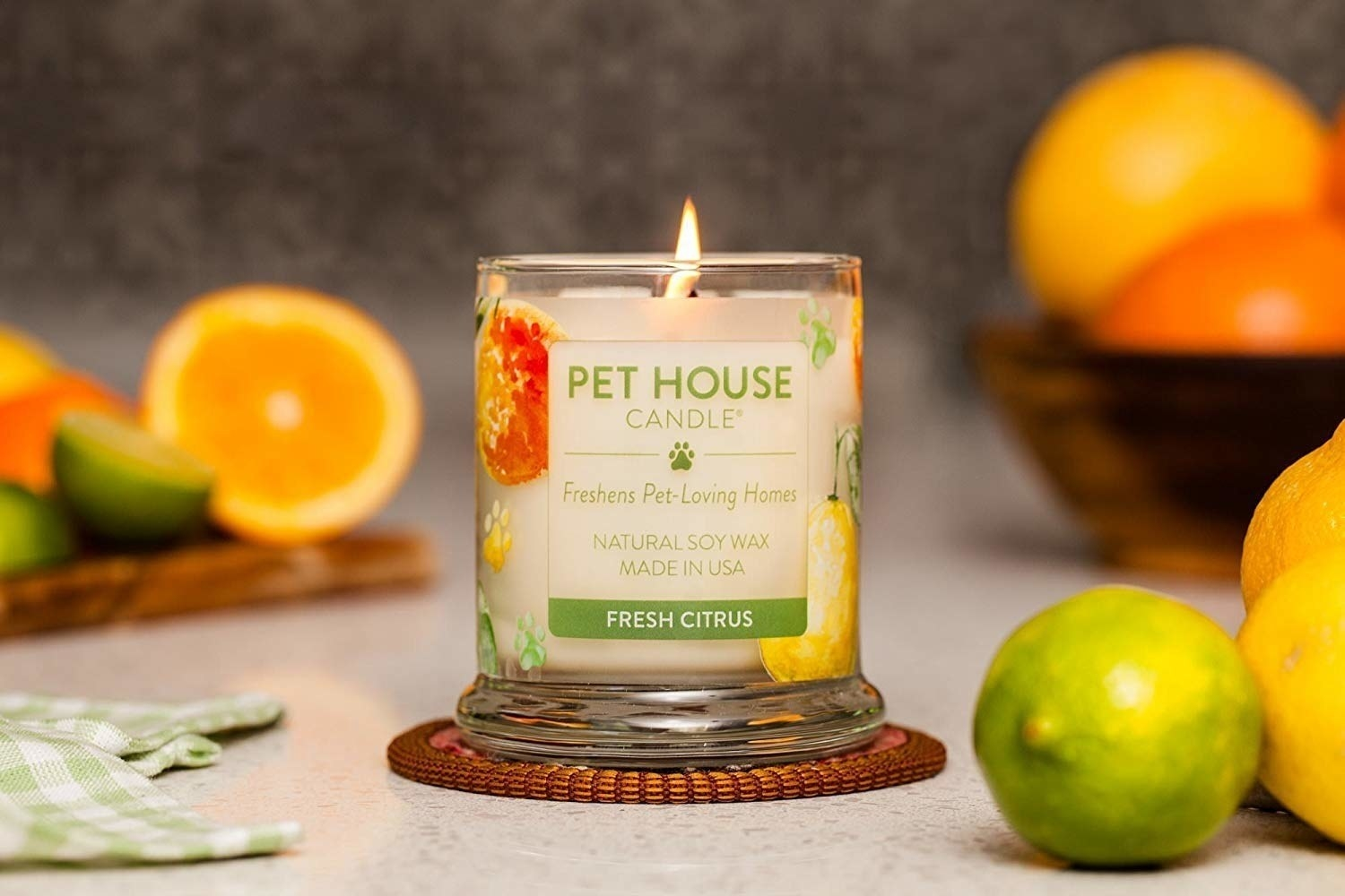 The lit candle in the fresh citrus scent