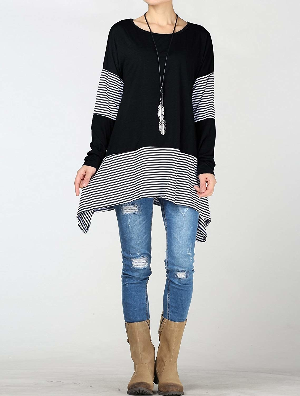 a model wearing the top in black with white stripes on the sleeves and at the bottom of the shirt