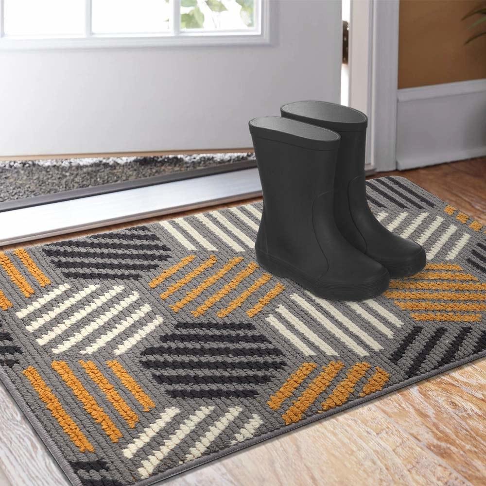 gray, yellow, and black abstract mat at door