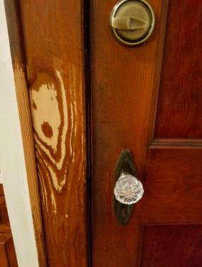 reviewer before pic of worn wood door frame