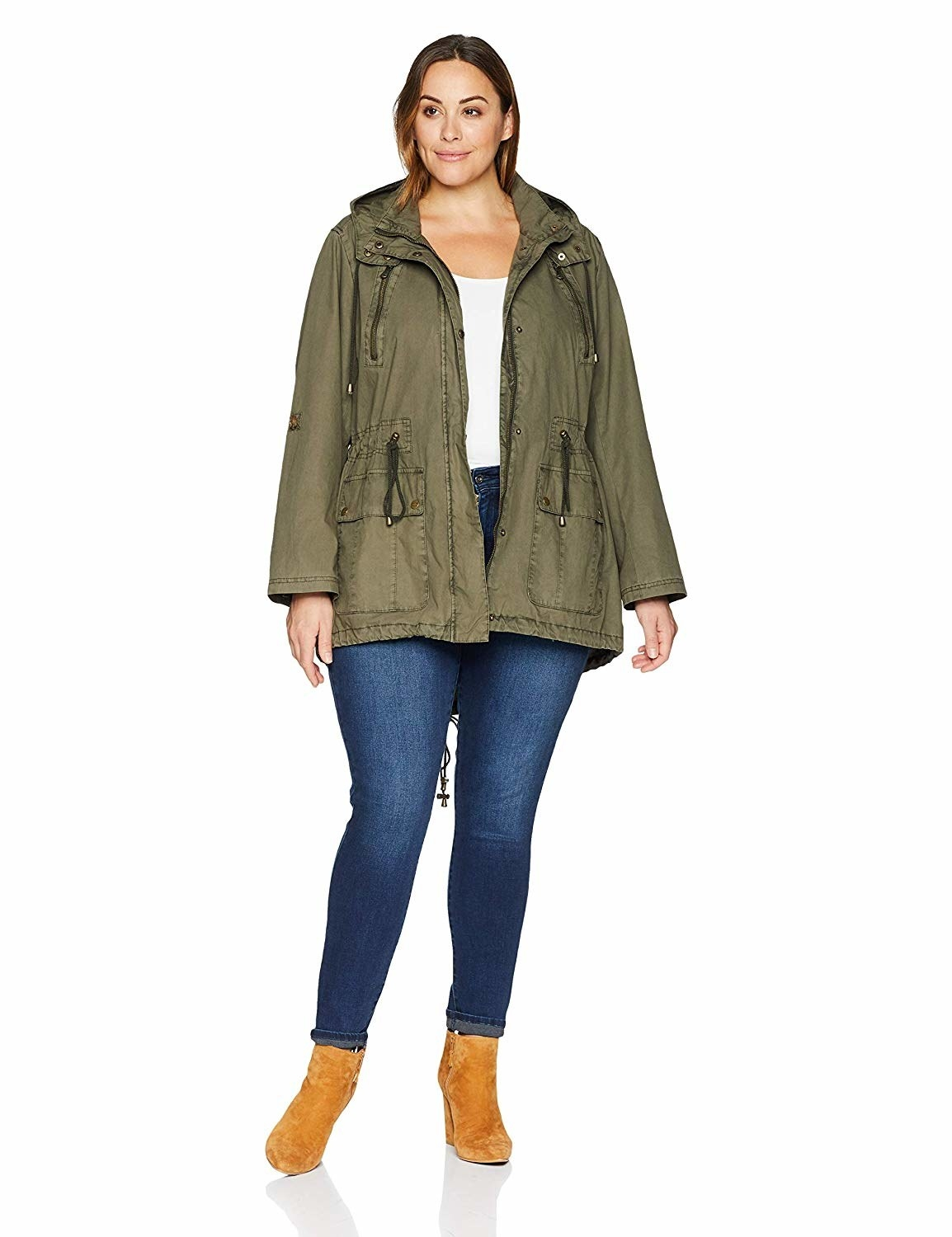 Model wearing the zipper-front utility jacket with drawstring around the middle and two large pockets on the bottom front and a hood