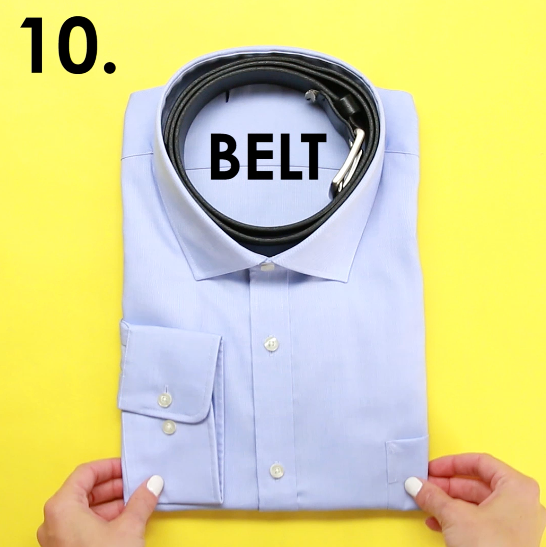 A collared shirt with a belt rolled up to fit inside the neckhole