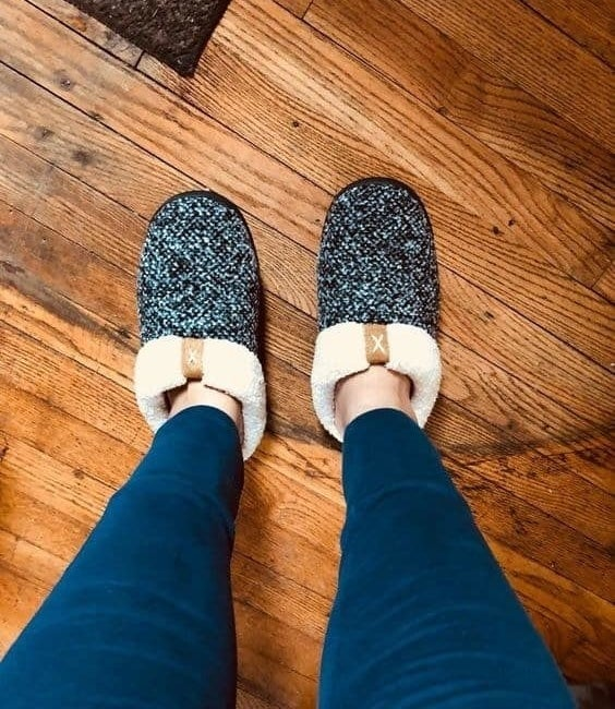 reviewer's grey speckled backless slippers with shearling trim