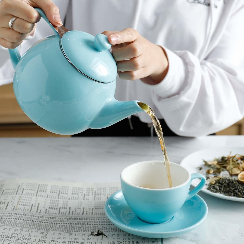 light blue teapot pouring tea