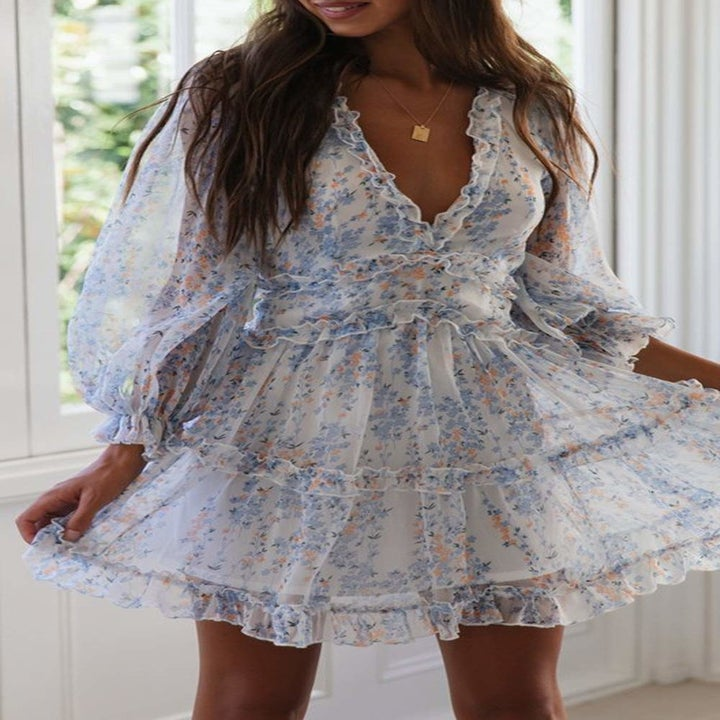Model wearing the white and blue printed dress