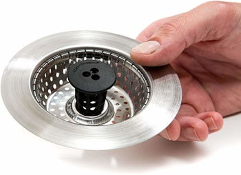 the stainless steel circular strainer with a black rubber middle grip