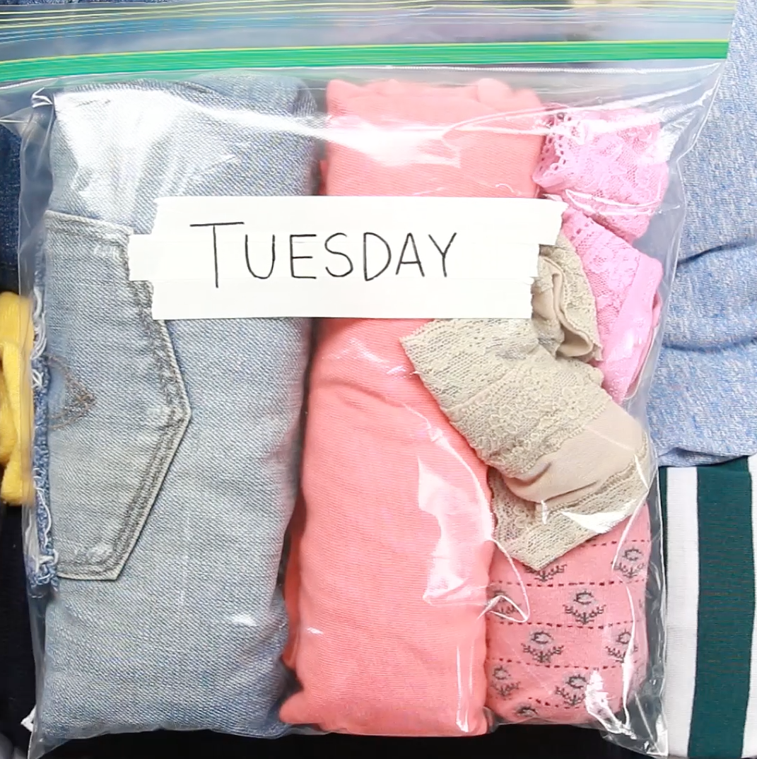 """A ziploc bag with clothes folded inside marked """"Tuesday"""""""