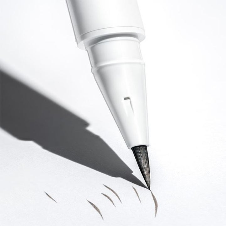 The Brow Flick Pen making markings on a white background