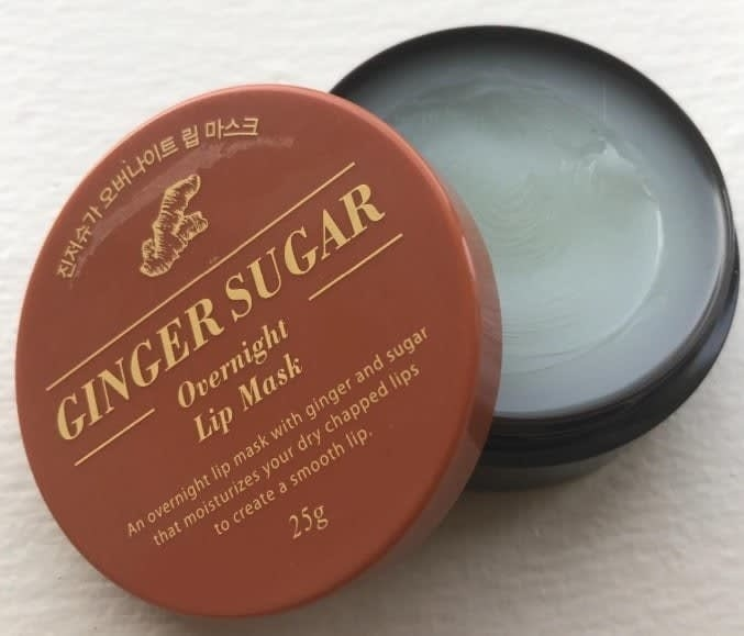 A tub of the ginger sugar overnight lip mask — the mask itself is an off-white jellyish color