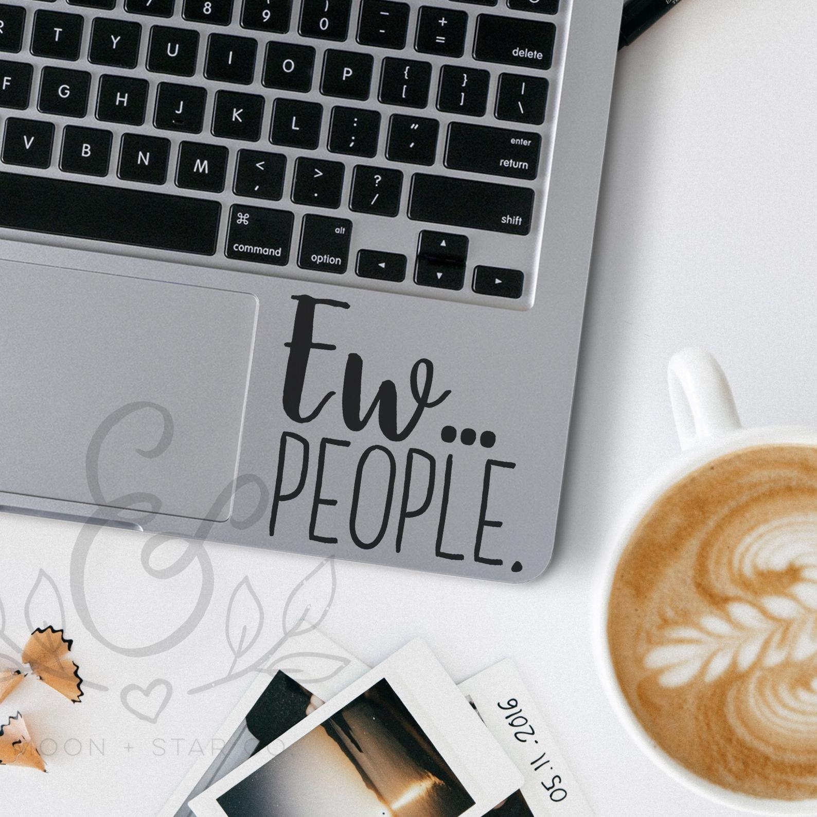 sticker on laptop that says ew people