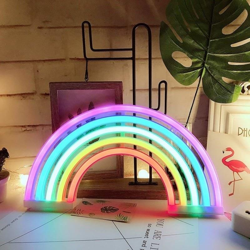 Rainbow neon light styled on a desk