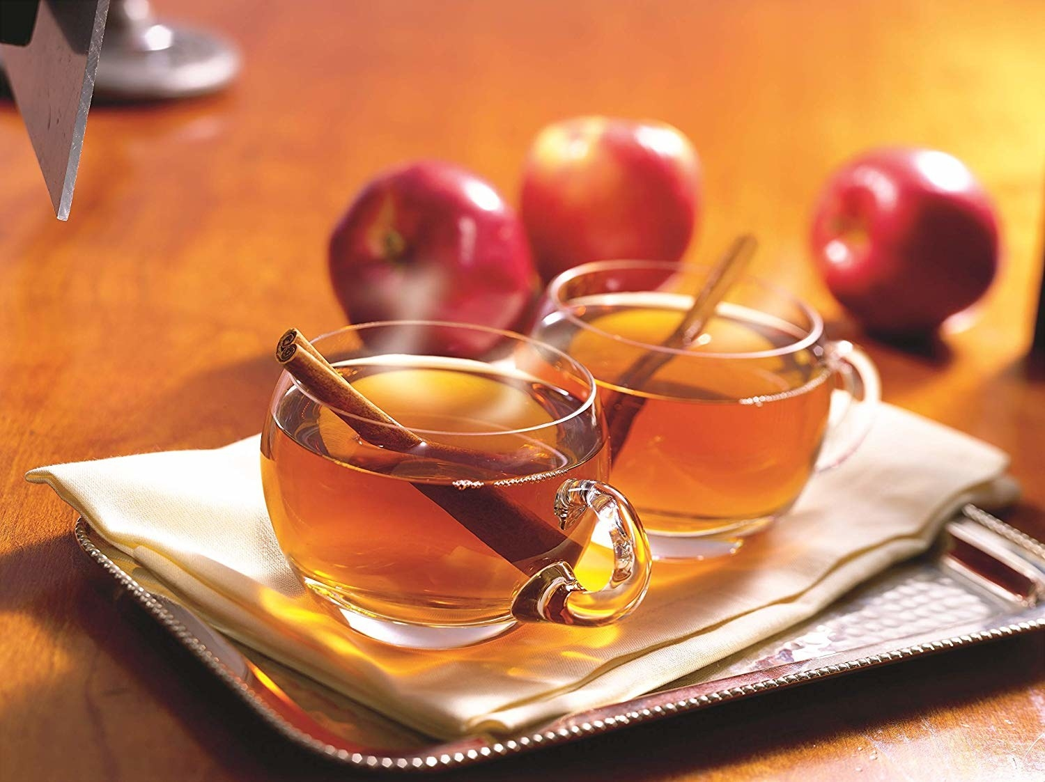 Two mugs of the golden-brown cider