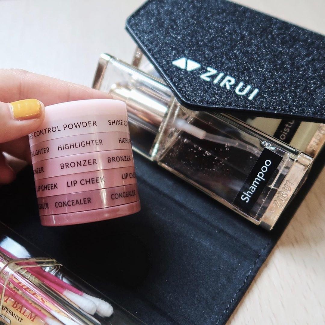 a stack of makeup essentials